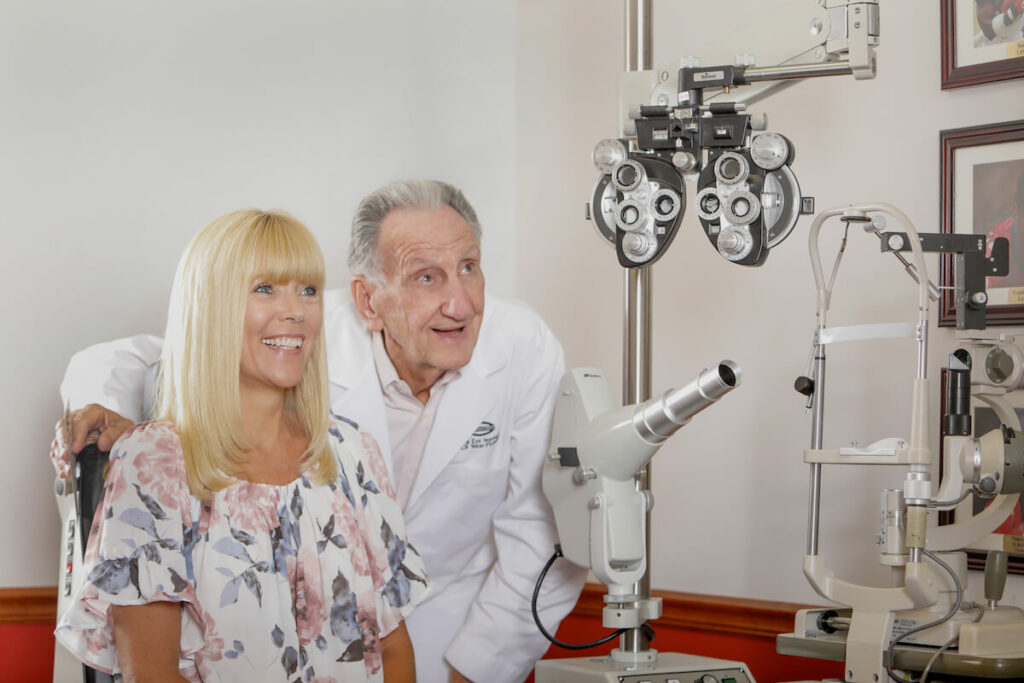 Doctor with a patient in an eye exam room